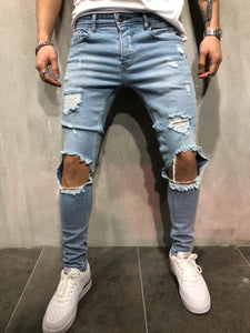Blue Ripped Knee Out Skinny Jeans