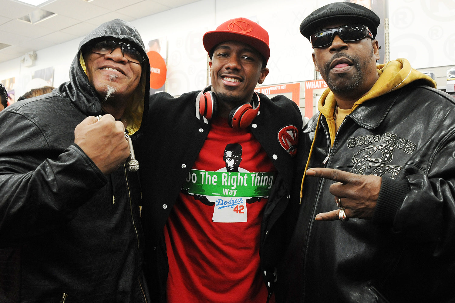 Nick Cannon (C) poses with rappers Melle Mel (L) and Grandmaster Caz during his launch of Ncredible product line at Radioshack on February 23, 2016 in New York City.