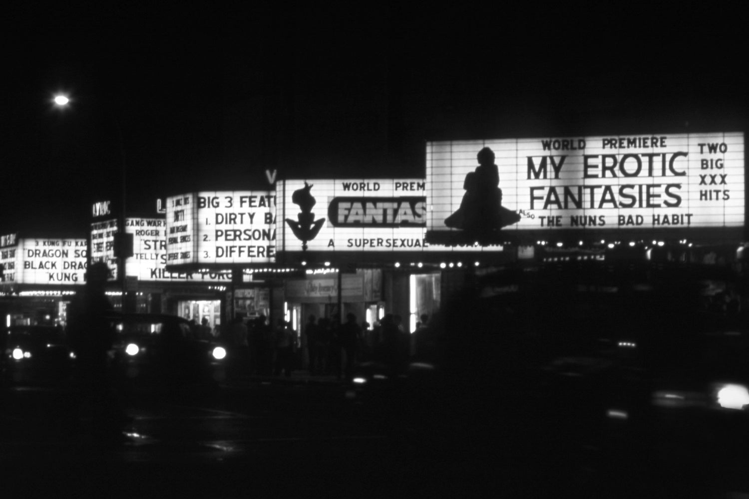 NEW YORK - 1976: A view of the marquees of cinemas on West 42nd Street including the RialtoII, the Rialto, the Victory Theatre, the Lyric Theatre and the Times Square Theater in 1976 in New York City, New York. (Photo by Donaldson Collection/Michael Ochs Archives/Getty Images)