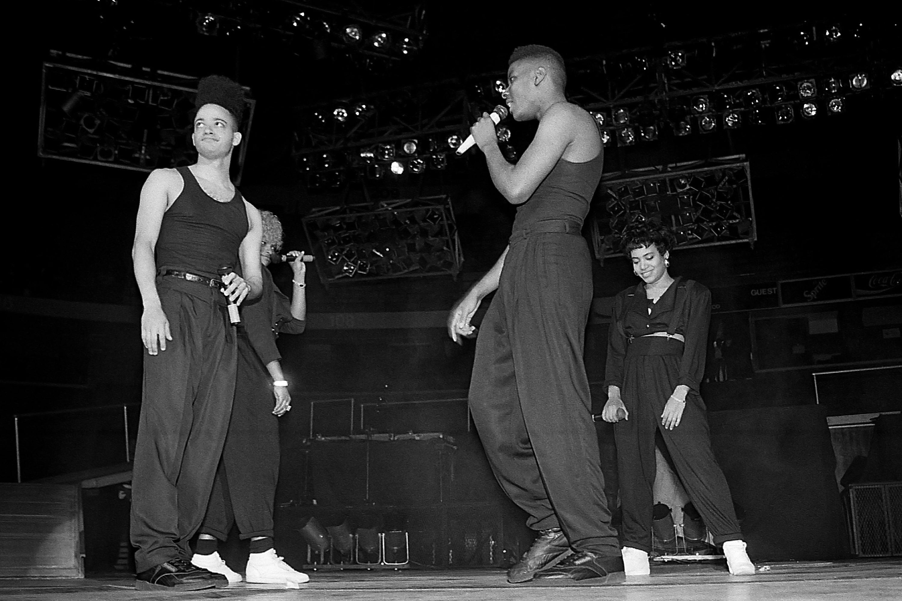 Pepa and Salt (rear) from Salt-N-Pepa joins rappers Kid and Play from Kid 'n Play on stage