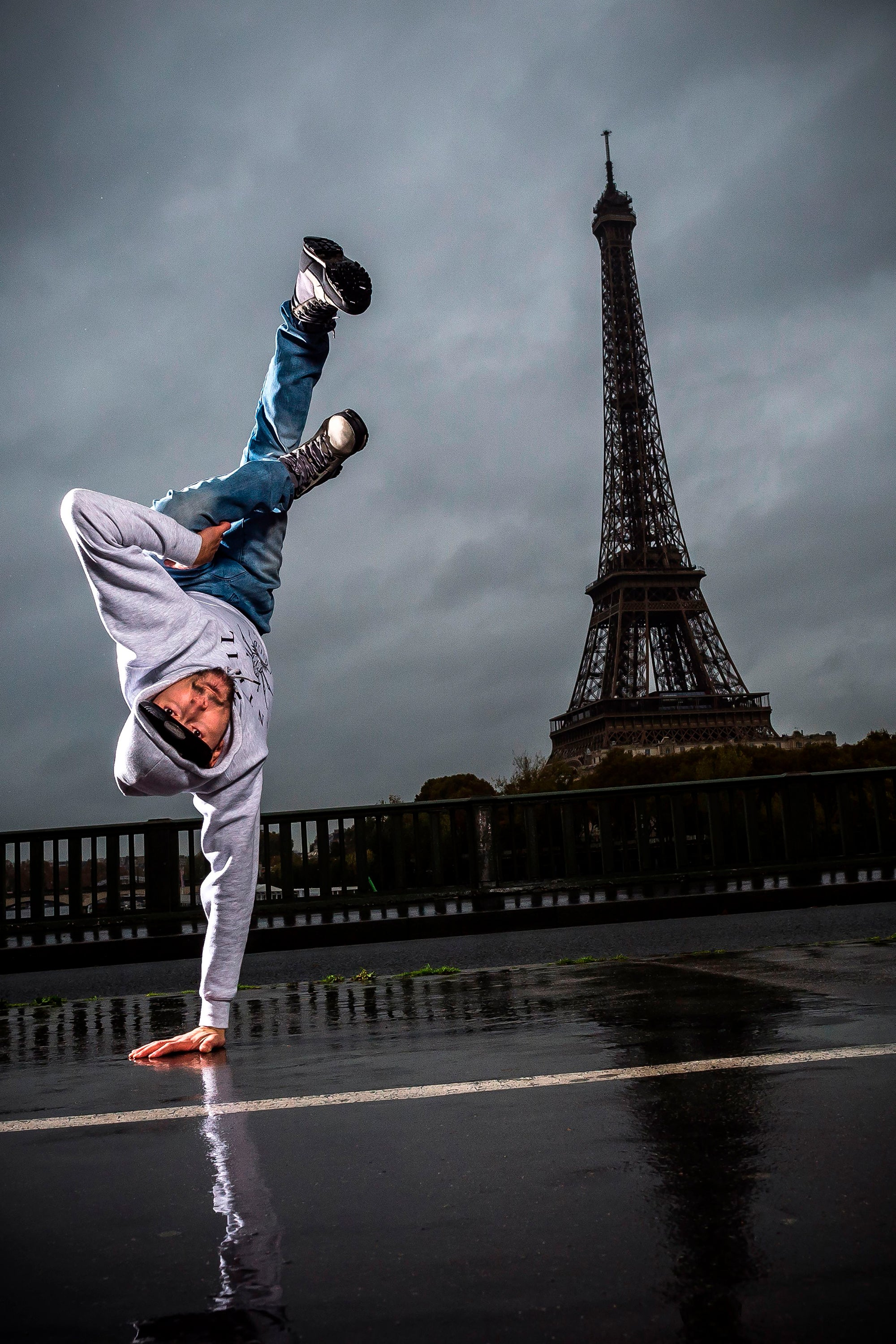 B-boy in front of the Eiffel Tower