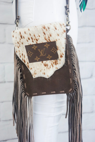 LOUIS VUITTON COWHIDE TASSEL BAG