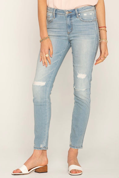 ON THE MOVE DISTRESSED SKINNY JEANS