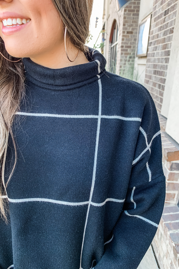 BLACK GRID MOCK NECK SWEATER