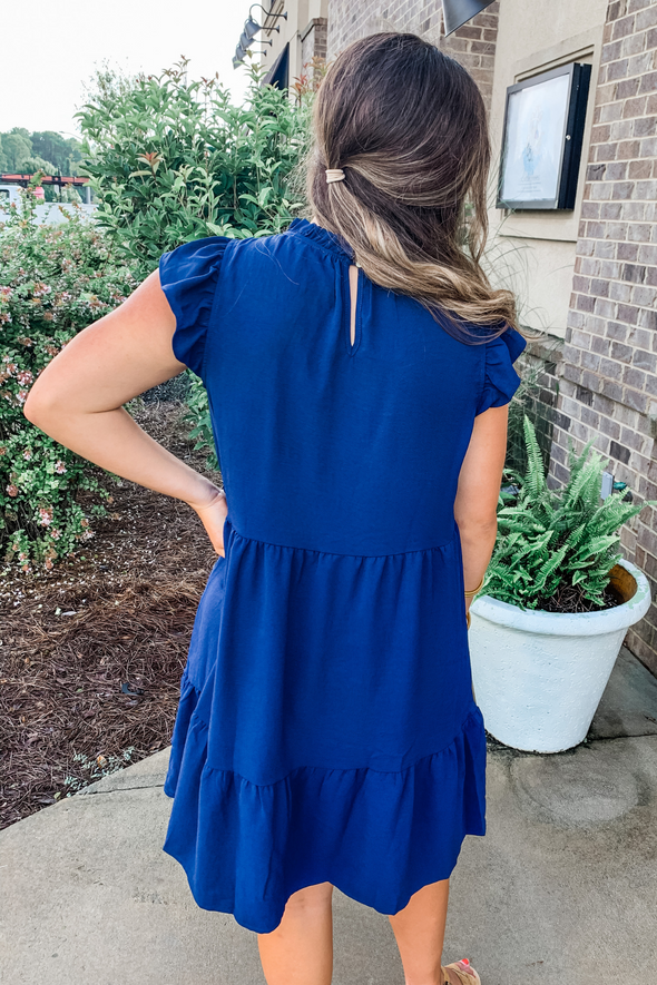 NAVY TIERED RUFFLE DRESS