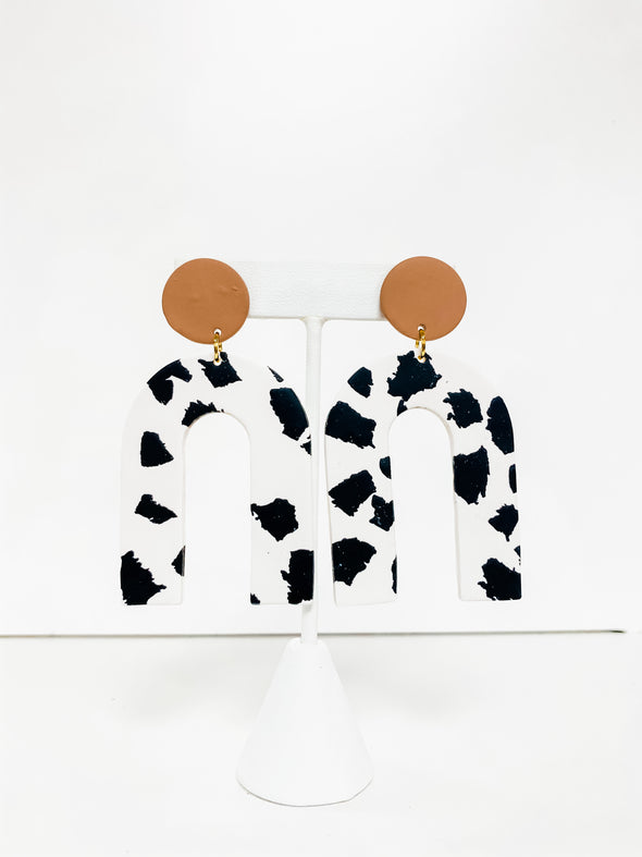 COW PRINT HIGH ARCHED CLAY EARRINGS