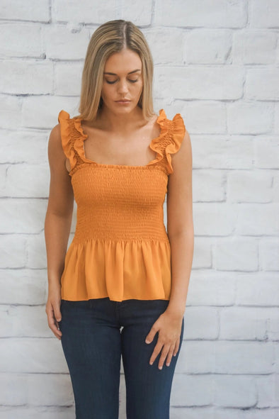 SMOCKED PEPLUM TANK IN MUSTARD
