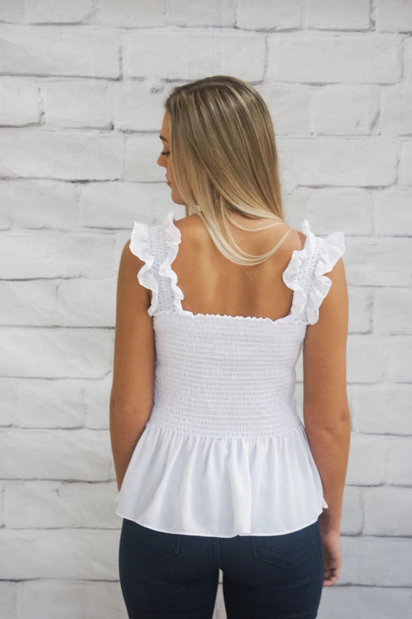 SMOCKED PEPLUM TANK IN WHITE