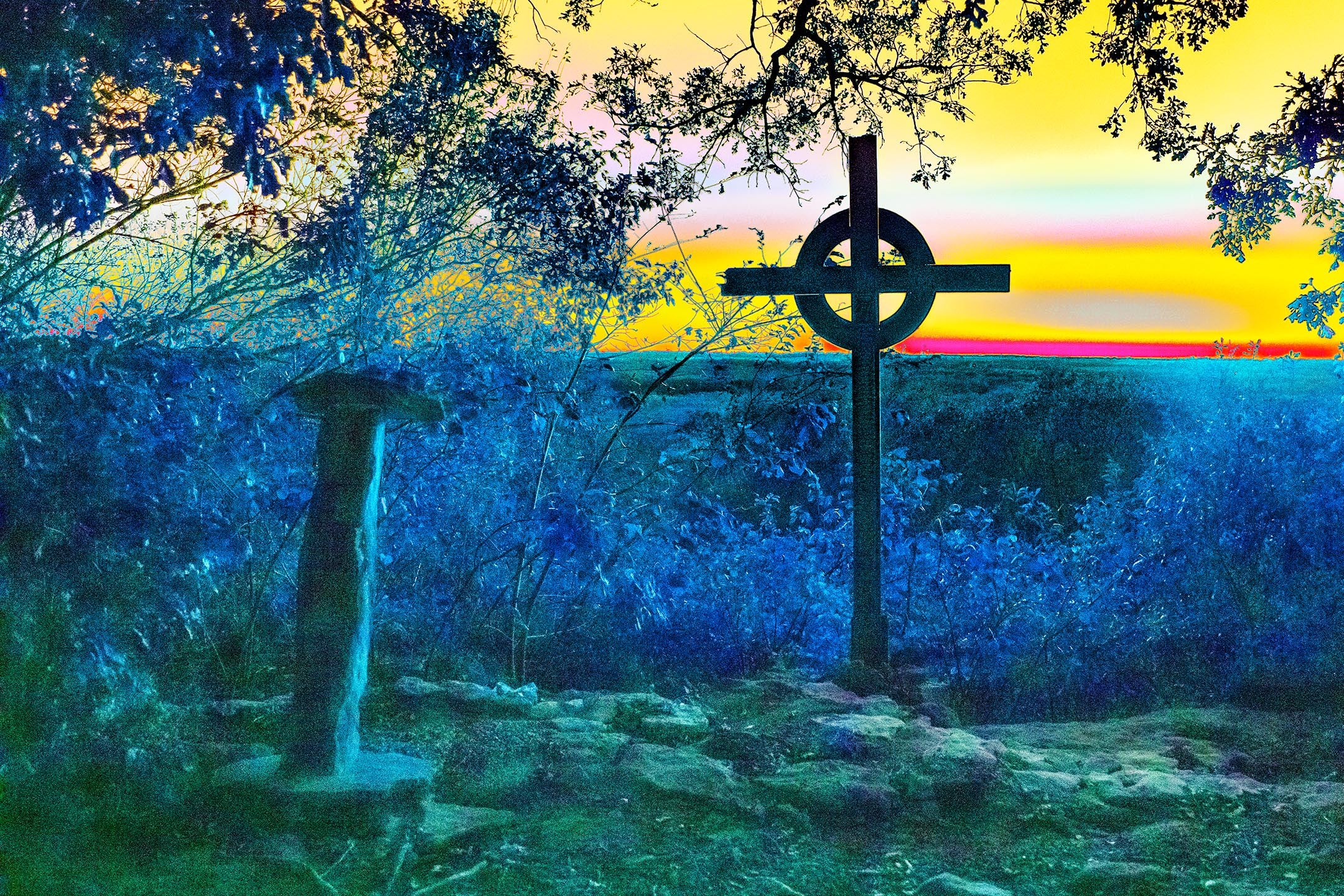 Cross on the Cliff at Sunset
