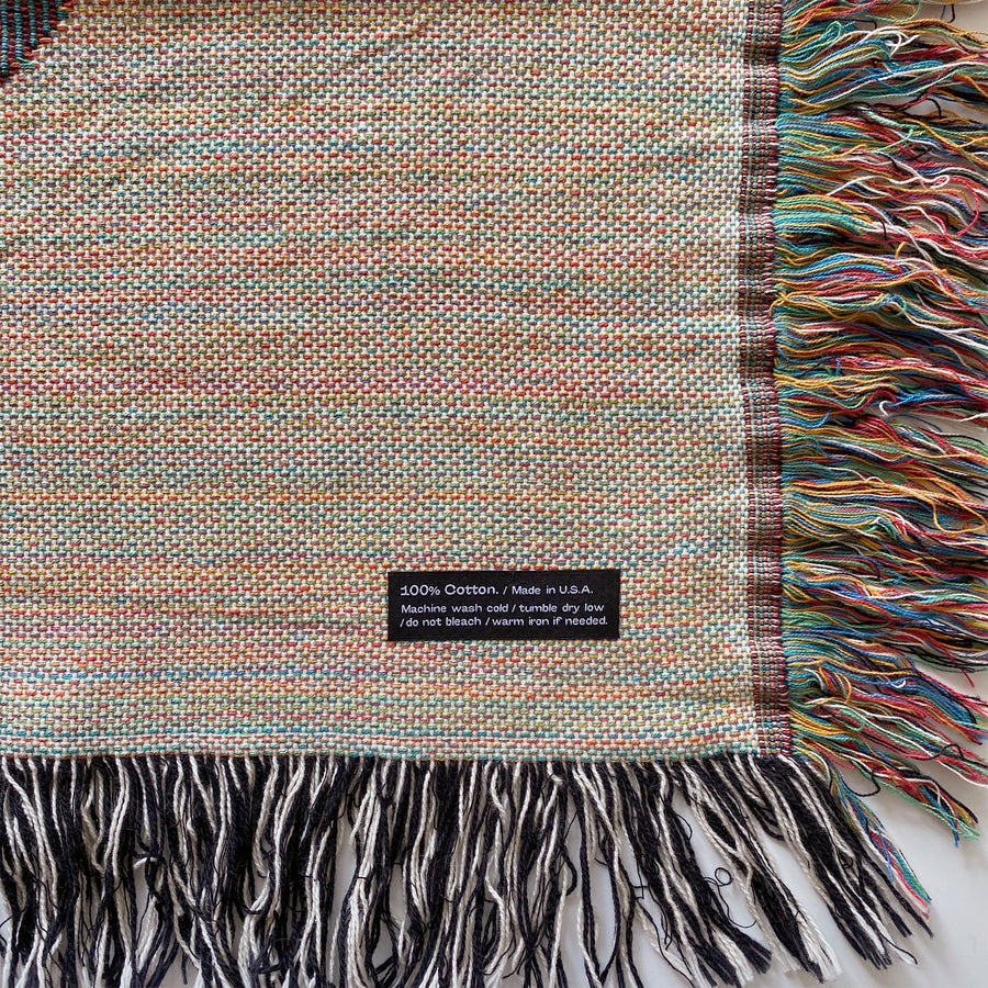 'NO' cotton woven throw blanket. Designed in Brooklyn, NY