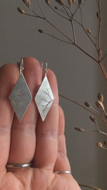 Load and play video in Gallery viewer, Dangling earrings in silver with cut out branch
