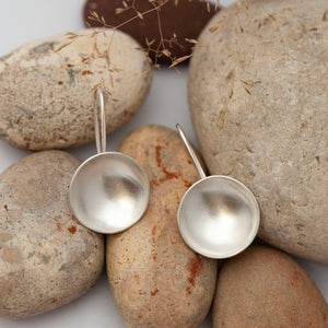 Short dangling earrings with silver bowls
