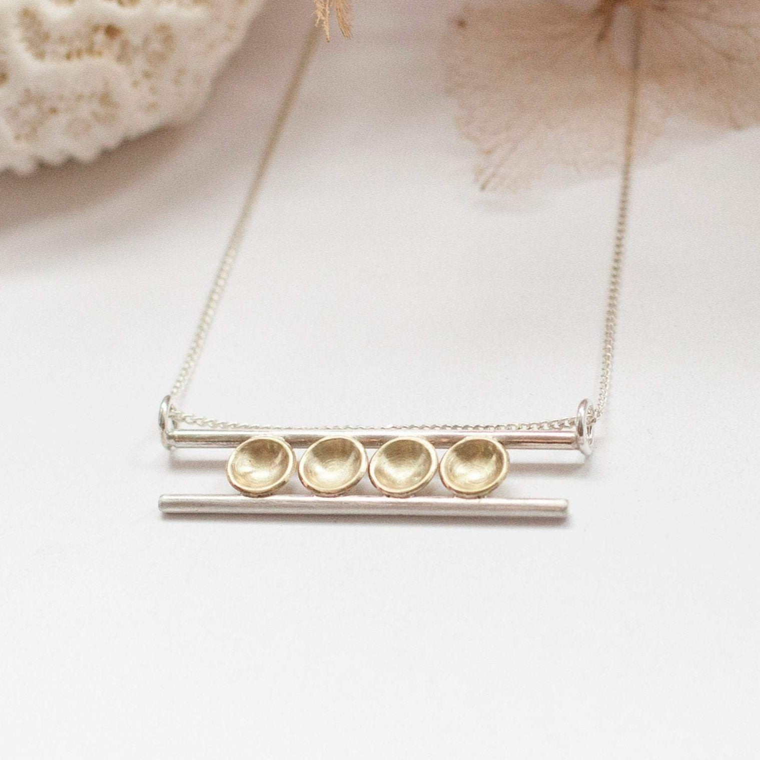 Pendant in brass and silver ~ 4 brass bowls on 2 silver bars