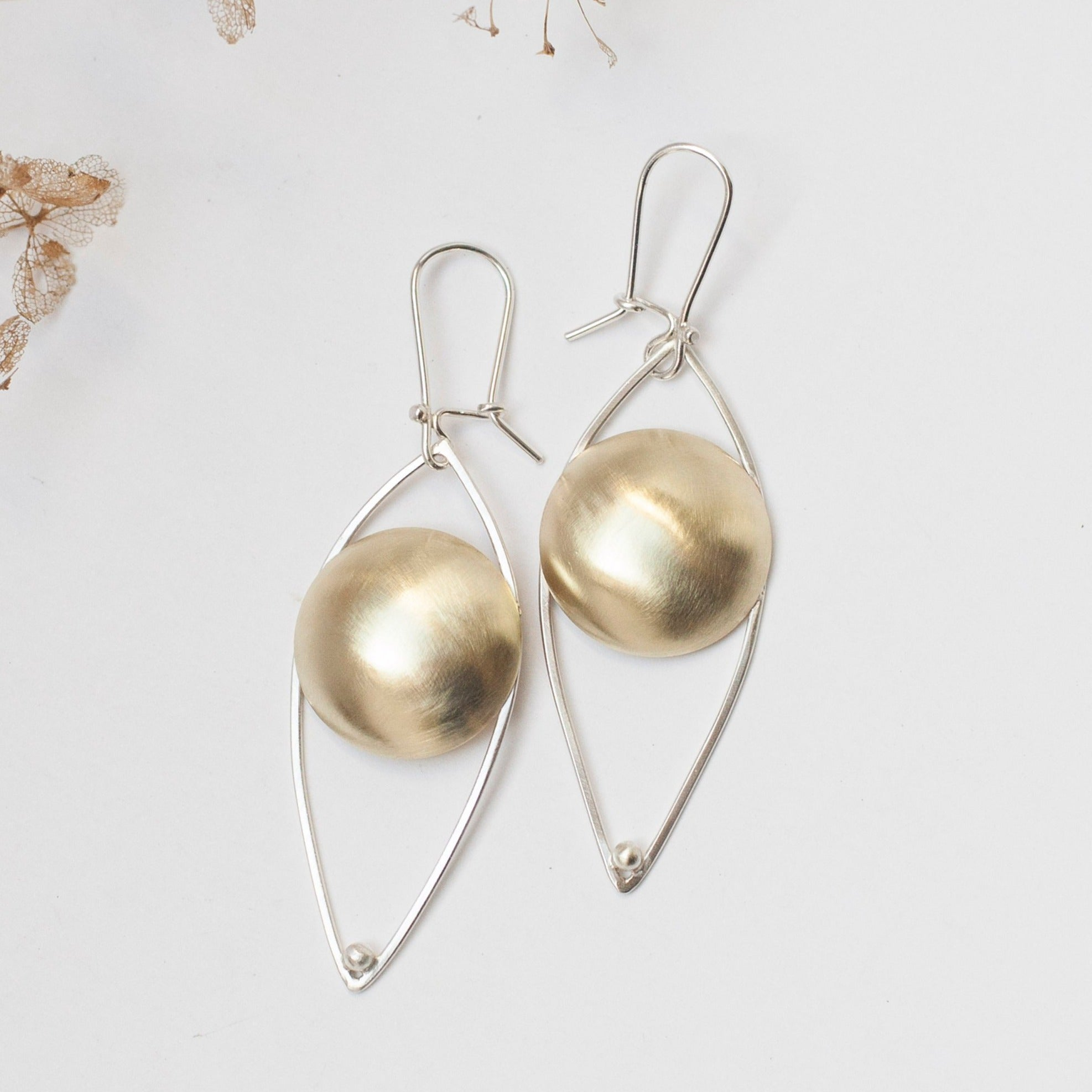 Mixed metals earrings ~ brass circle on silver structure