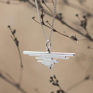 Silver pendant composed of an accumulation of lines