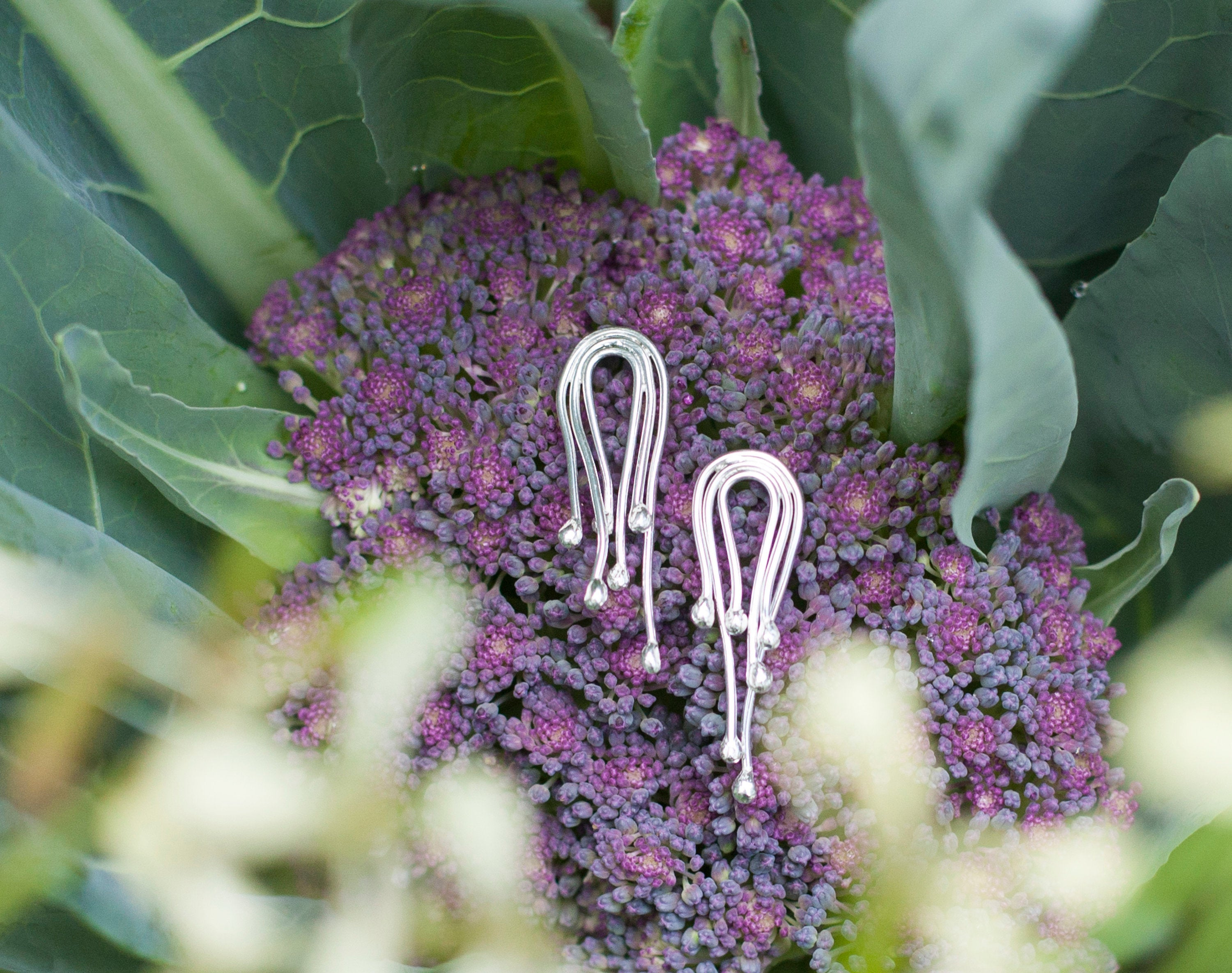 Organic earrings composed of tiny silver drops