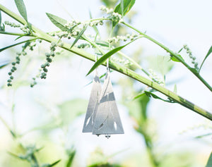 Long dangling triangle earrings in silver with cut out vegetal