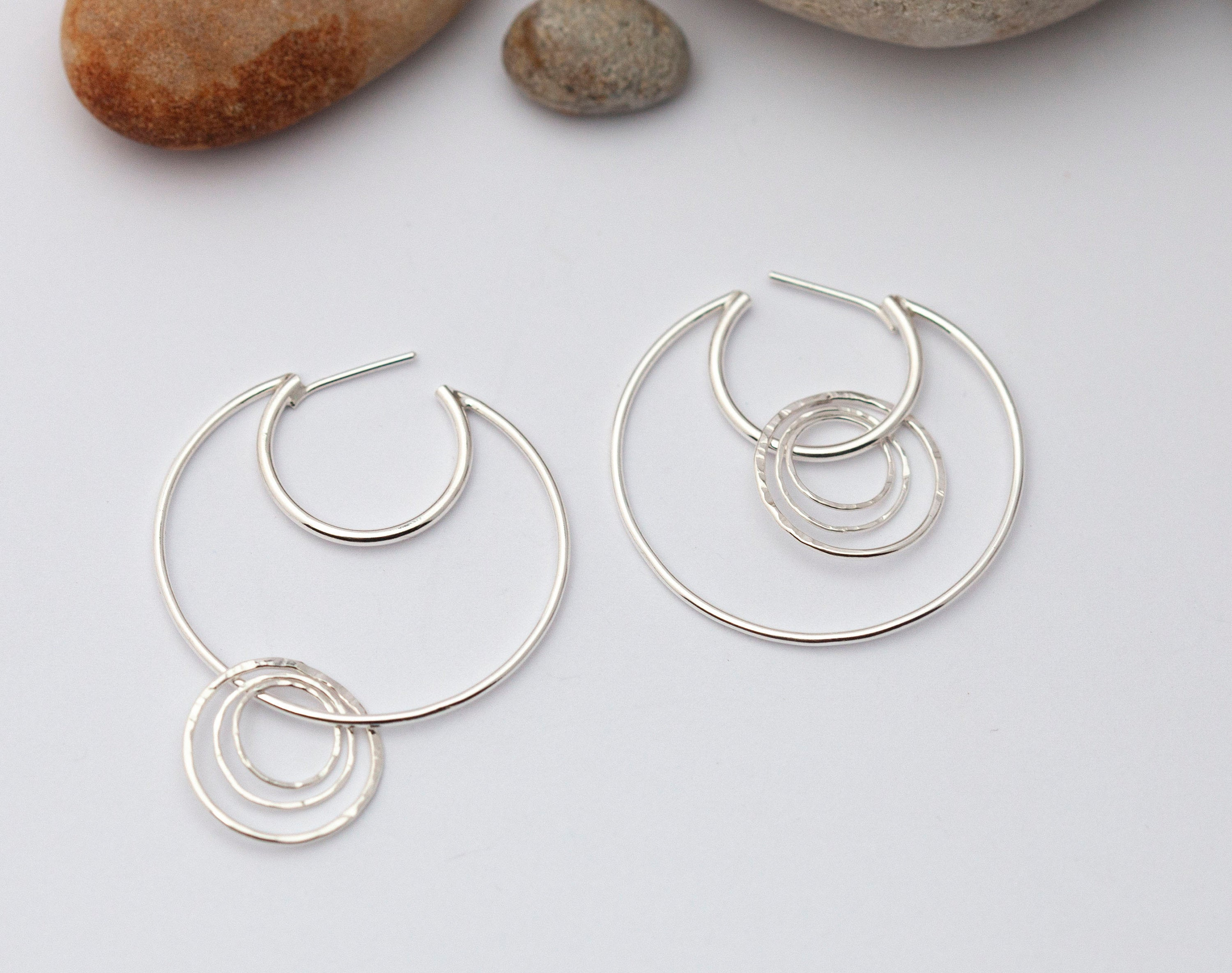 Crescent moon hoop earrings in silver ~ many rings with hammered texture