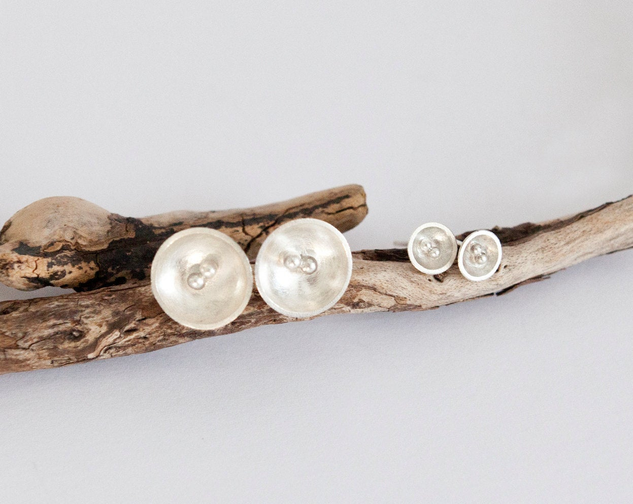 Tiny silver bowl earrings with little balls