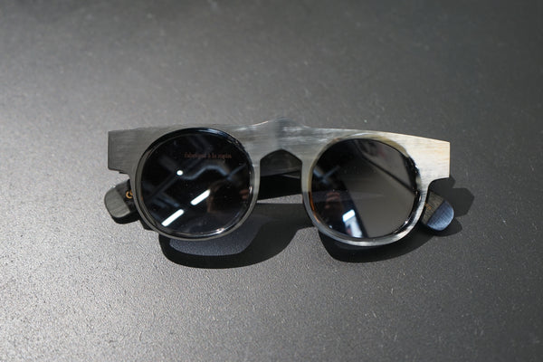 BLACK AND WHITE HORN SUNGLASSES WITH BLACK LENS