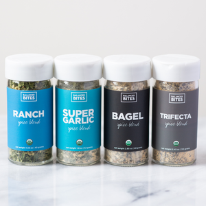 The Everyday Favorites Spice Pack by Balanced Bites Spices includes Ranch, Super Garlic, Bagel, and Trifecta spice blends.