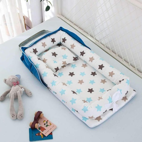 Portable Changing Pad -  Built-in Head Cushion giving your baby a soft, comfortable surface to rest!