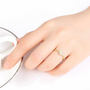 Woman Wearing 14k Yellow Gold Heart Shaped Inlaid Zirconia Thin Dainty Ring