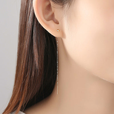 Woman Wearing 18K Gold Thin Long Linear Bar Dangle Drop Cable Link Earrings