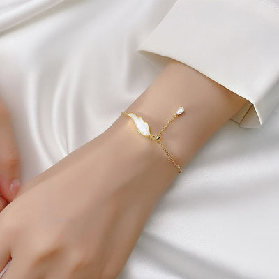 Woman Wearing Adjustable 18K Gold Plated Sterling Silver Angel Wing Zirconia Bracelet