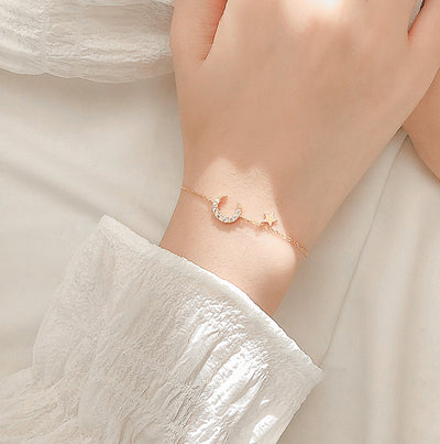 Woman Wearing Dainty Crescent Moon And Star Cubic Zirconia Gold Plated Sterling Silver Bracelet