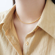 Woman Wearing Large Ball Chain Beaded Pelline Clavicle Necklace In Gold Plated Sterling Silver