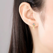 Woman Wearing Multi Colored Colorful Candy Moon And Star Mismatched Cubic Zirconia Earrings In 18K Gold Plated 925 Sterling Silver