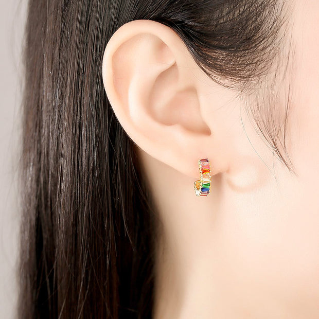 Woman Wearing Multi Colored Colorful Candy Small Open Huggie Hoop Cubic Zirconia Earrings In 18K Gold Plated 925 Sterling Silver