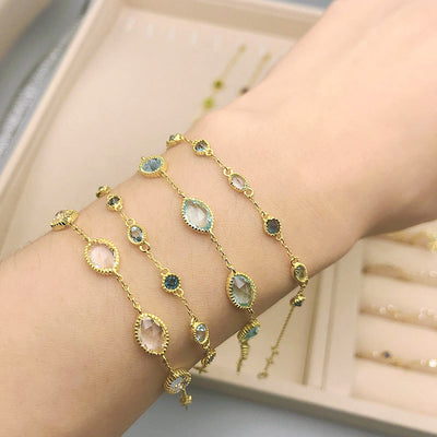 Woman Wearing Sapphire Blue And Gold Sterling Silver Multi Gemstone Bracelet