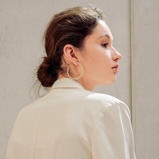 Woman Wearing Sterling Silver J Hoop Chain Link Hoop Earrings