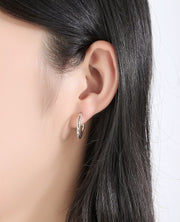 Woman Wearing 3/4 Hoop Huggie 925 Sterling Silver & Cubic Zirconia Earrings