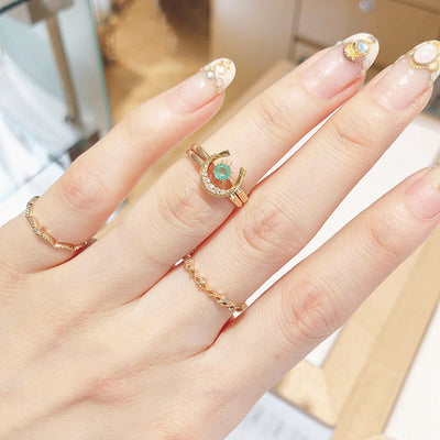 Woman Wearing U Shaped Horseshoe North Star 2 Piece 18K Gold Plated Sterling Silver Ring Set