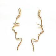 half girl woman face earrings gold color