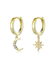 gold plated moon and star earrings set plain white background