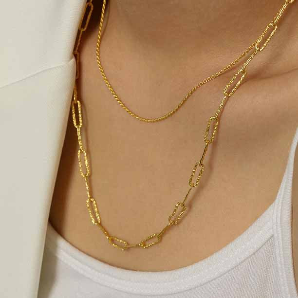 woman wearing diamond cut wide link 14k gold sterling silver chain necklace