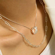 woman wearing diamond cut wide link sterling silver chain necklace