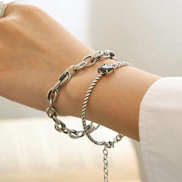 woman wearing half rope link and cuban chain link black gemstone solid 925 sterling silver bracelet