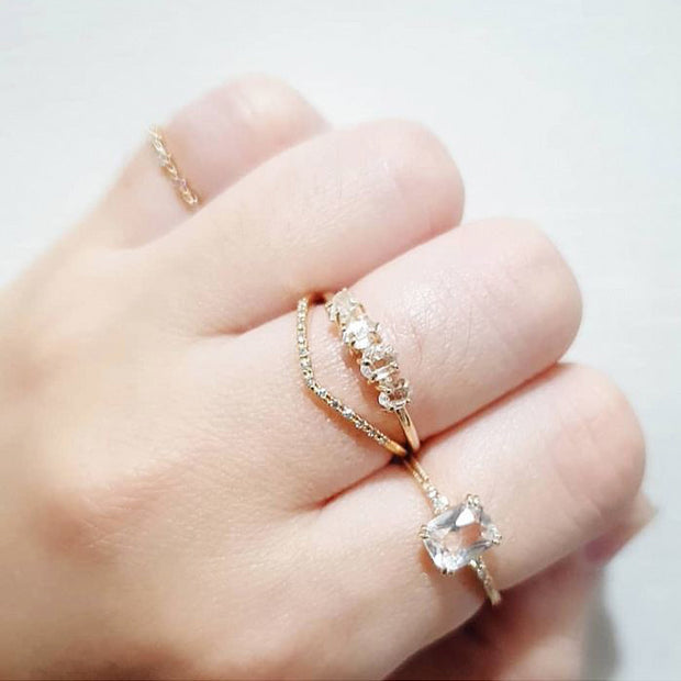 woman wearing natural crystal stackable 14k gold plated engagement style ring