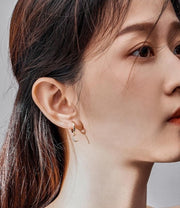 woman gold plated wearing moon earring