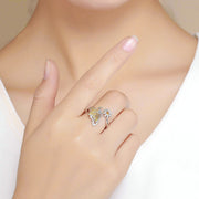woman wearing yellow butterfly with flower 925 sterling silver rhodum plated cubic zirconia ring