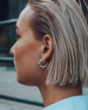 Triple nipple silver hoops
