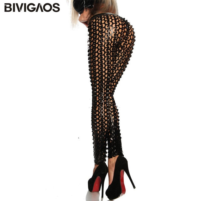 f1c3db3b4f5b05 Women'S Gothic Punk Rock Metal Bright Pierced Scales Hole Ripped Pu Leather  Elastic Leggings Stretch Pants