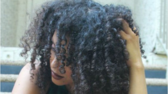 black woman dandruff curly hair