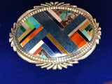 Native American handcrafted sterling silver belt buckle with intricate inlay of genuine stones.