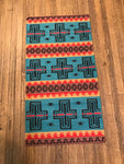 Turquoise and red in Chief Blanket design handwoven rug